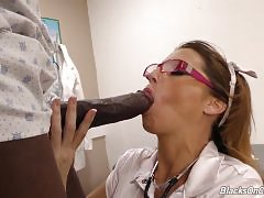 Instead of her regular nurse`s scrubs, she`s put on a sexy, slutty outfit. She`s out to seduce Dingo right there in the office. She`s got a good idea he`s well-endowed, and she wants a taste of his black meat.